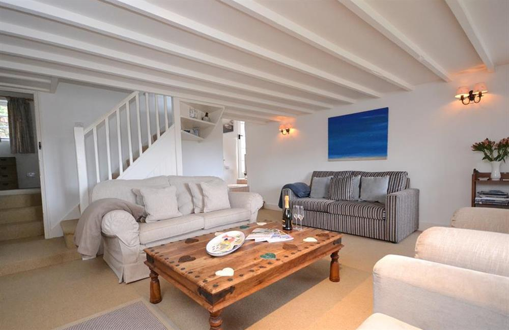 The living room with the single room at the bottom of the stairs at Meadow View Cottage, Dittisham