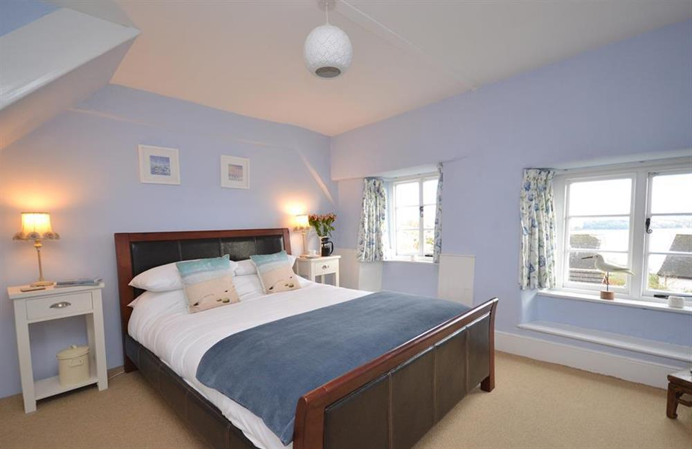 The master bedroom with views of the River Dart at Meadow View Cottage, Dittisham