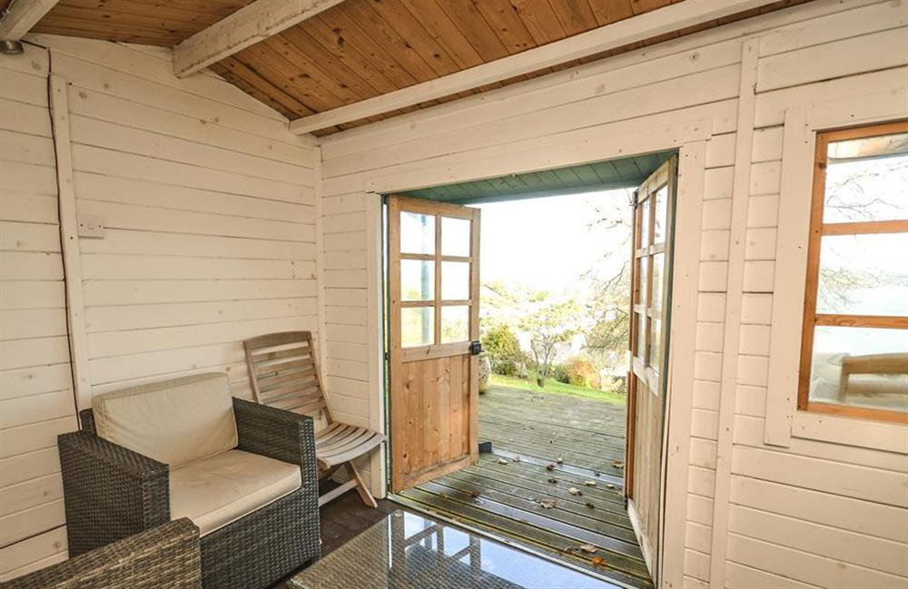 The summerhouse at the top of the garden at Meadow View Cottage, Dittisham