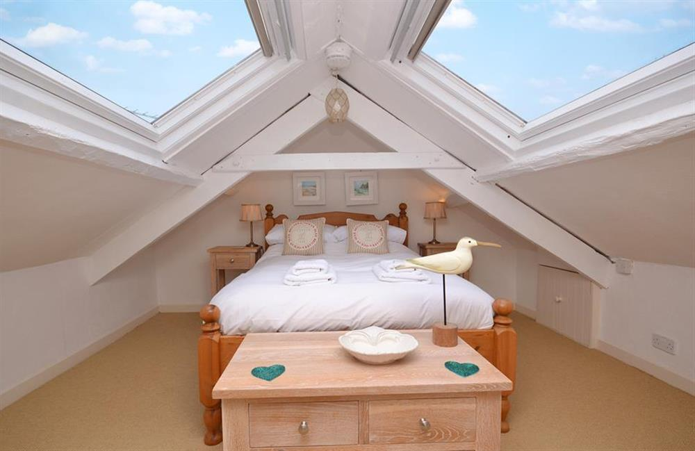 The top floor bedroom with views over the village and the River Dart beyond at Meadow View Cottage, Dittisham