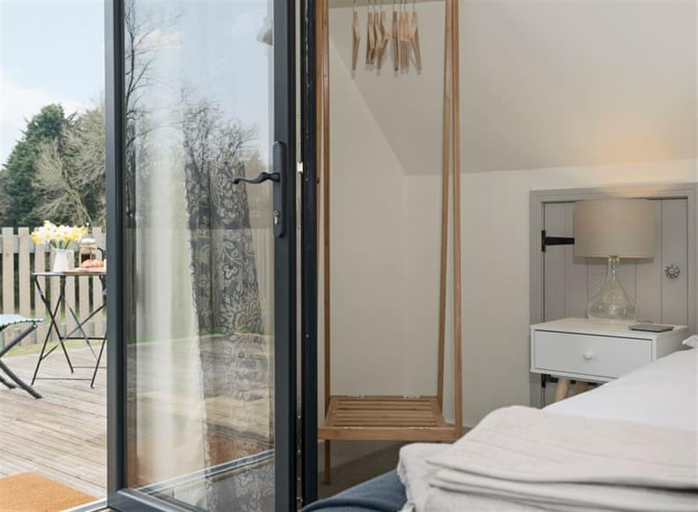 Tastefully furnished double bedroom with French door leading to balcony (photo 2) at Meadow View in North Walsham, Norfolk