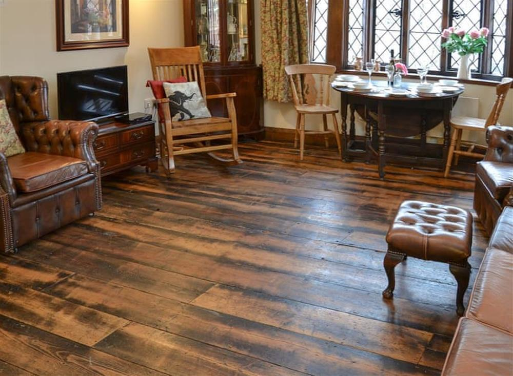 Living room with dining area at Medieval Apartment in Ipswich, Suffolk