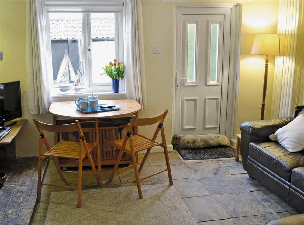 Homely living room/dining room at Middle Cottage in Bacton, near Norwich, Norfolk