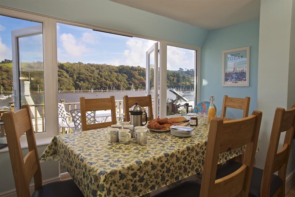 Dining area with lovely views from the bay window at Middle Watch in , Dartmouth