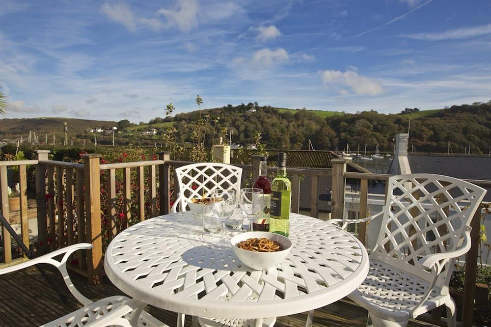 The decking area has a table and four chairs at Middle Watch in , Dartmouth
