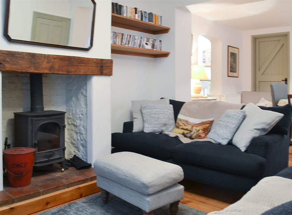 Cosy living area with wood burner at Mill Cottage in Letheringsett, near Holt, Norfolk