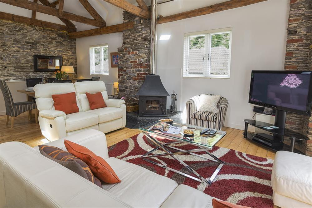 Cosy sitting area with wood-burning stove at Mill Grange in , Dartmouth