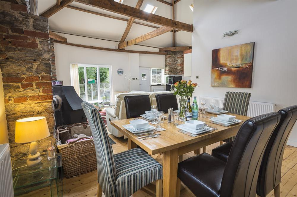 Dining area with oak table seating six at Mill Grange in , Dartmouth