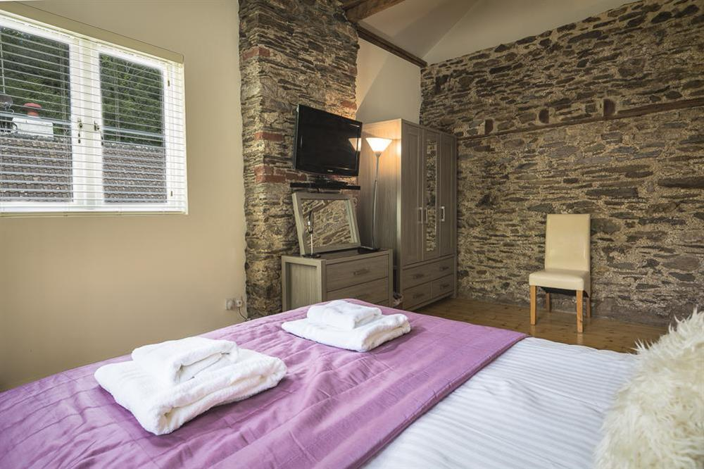 Double bedroom with King-size bed (ground floor) (photo 3) at Mill Grange in , Dartmouth