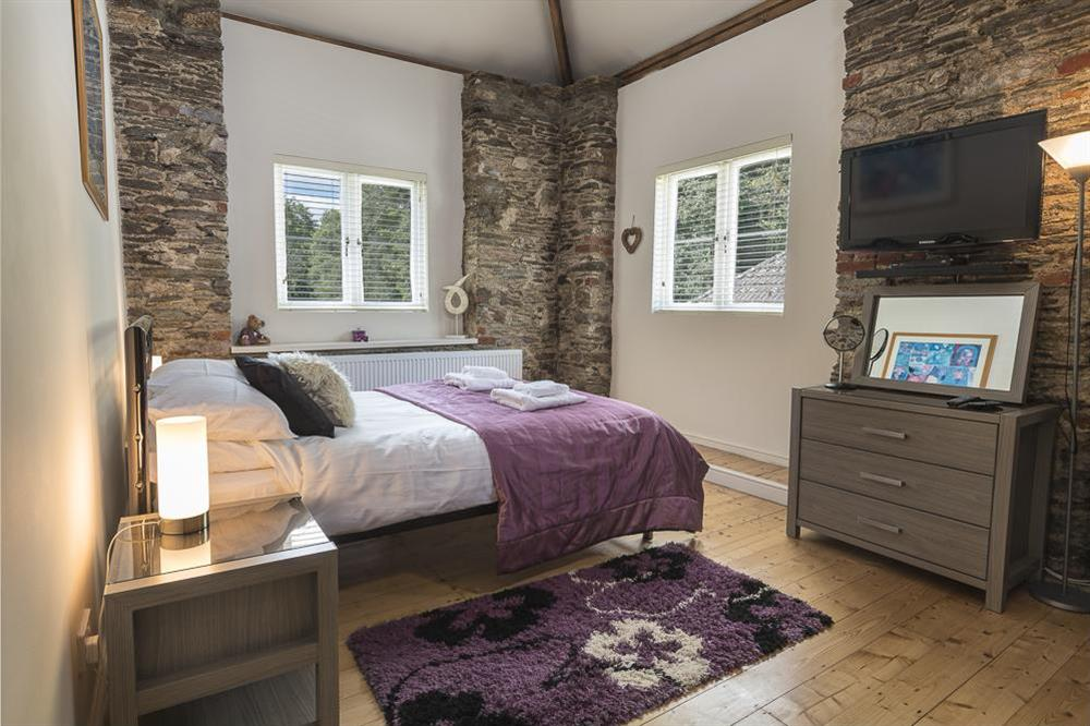Double bedroom with King-size bed (ground floor) at Mill Grange in , Dartmouth