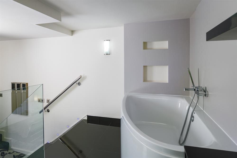 En suite bathroom with corner bath (photo 2) at Mill Grange in , Dartmouth