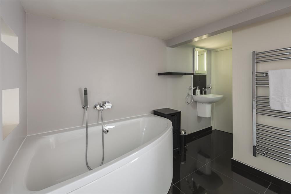 En suite bathroom with corner bath at Mill Grange in , Dartmouth