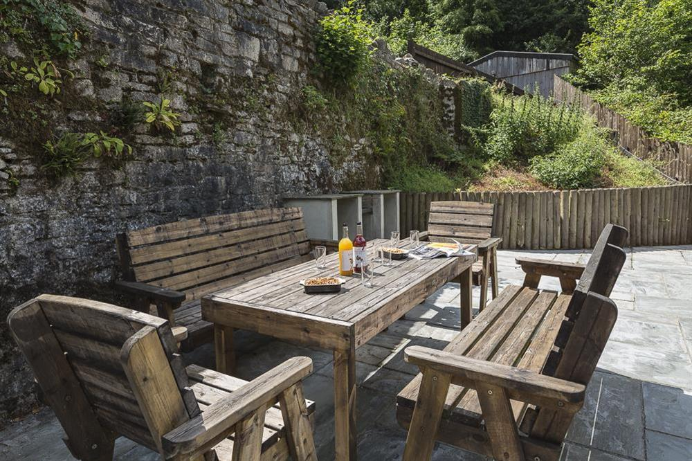 Furnished terrace with built-in barbeque available at Mill Grange in , Dartmouth