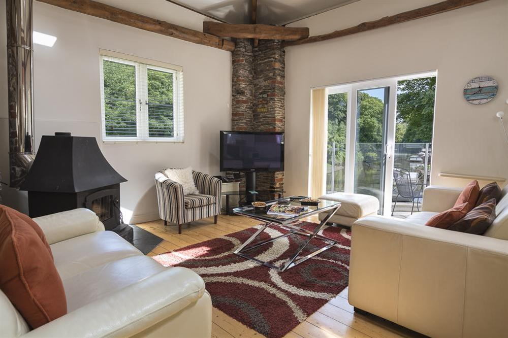 Living area with doors leading out to the terrace at Mill Grange in , Dartmouth