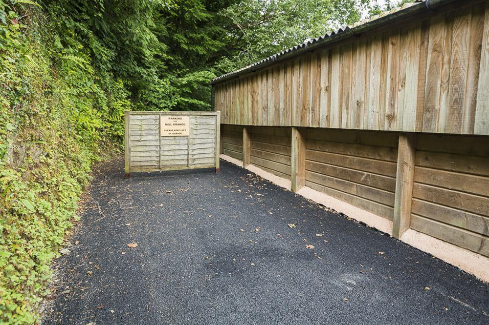 Parking for three cars in front (and to the left) of the wooden garage area 50m from cottage (photo 2) at Mill Grange in , Dartmouth