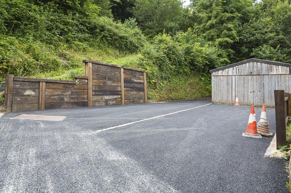 Parking for three cars in front (and to the left) of the wooden garage area 50m from cottage at Mill Grange in , Dartmouth