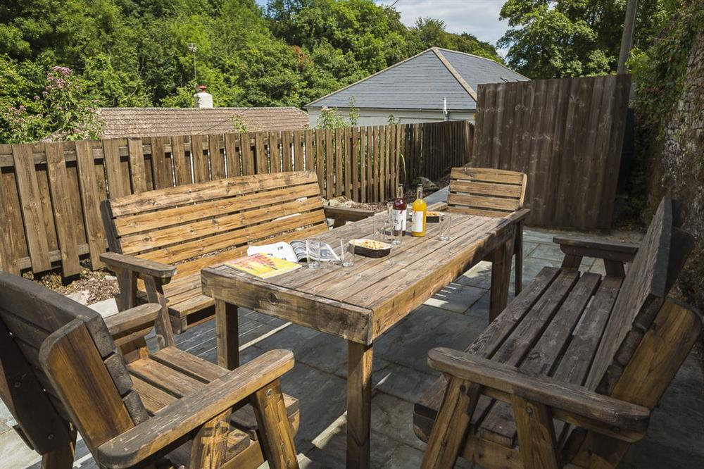 To the side/rear is a larger terrace ideal for al fresco dining and late sunny evenings at Mill Grange in , Dartmouth