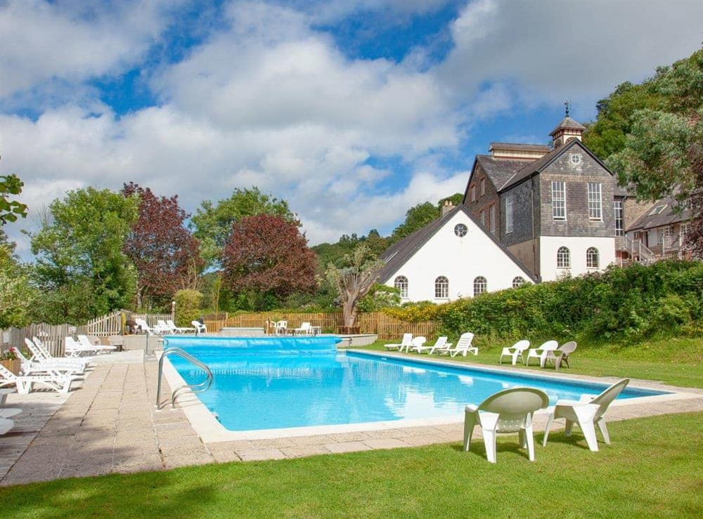Outdoor pool at Mill Lodge in Bow Creek, Nr Totnes, South Devon., Great Britain