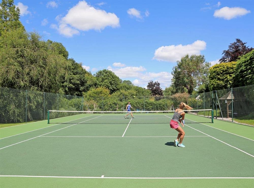 Tennis court at Mill Stream in Bow Creek, Nr Totnes, South Devon., Great Britain