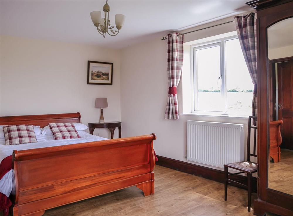 Master bedroom with wooden floors at Millers House,