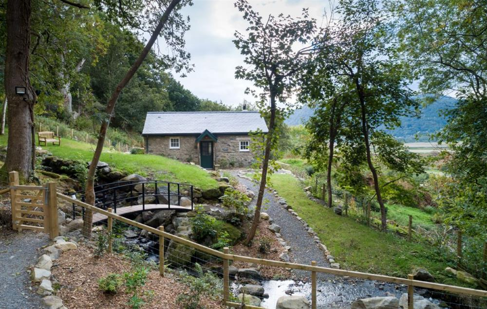 This detached cottage lies on its own off a woodland track with a pretty stream tumbling past at Minafon, Colwyn Bay