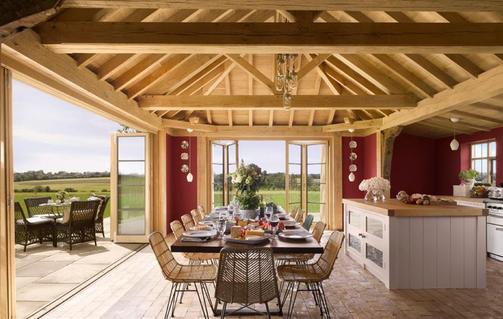 Ground floor: Kitchen with bi-fold doors onto the patio at Moat Cottage, Sibton Park