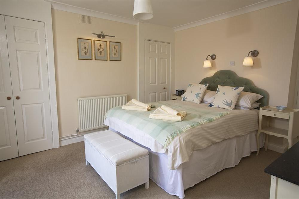 Double bedroom with King-size bed and en suite bathroom (photo 2) at Moonrakers in , Dartmouth