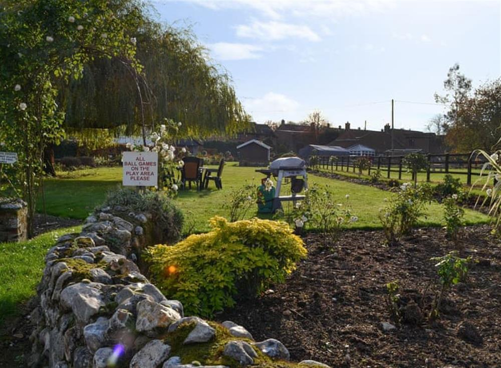 Shared garden seating area at Stable Cottage 7,