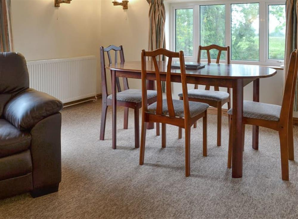 Stylish living and dining room at Stable Cottage 8,