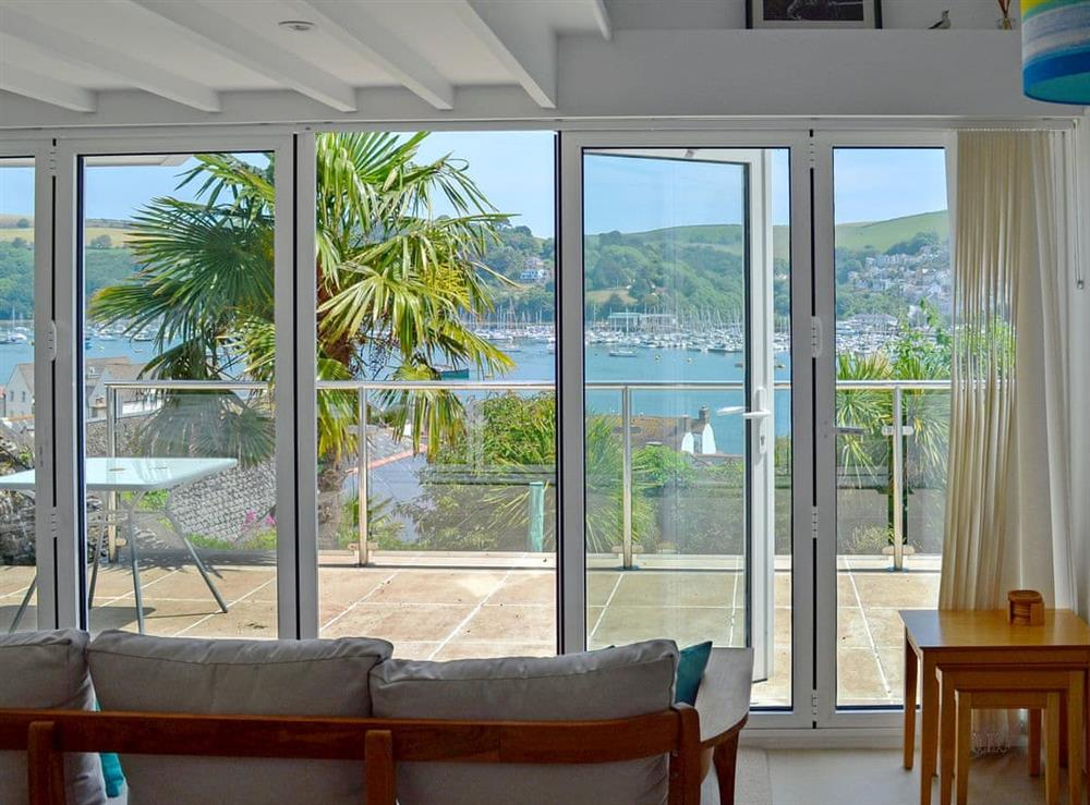 Living room located in an elevated position with stunning views over the river, across to Kingswear and out to sea at Morning Sun, Above Town 47 in Dartmouth, Devon