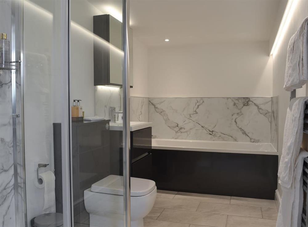 Bathroom with separate shower at Moss Hall Barn in Rushton, near Tarporley, Cheshire