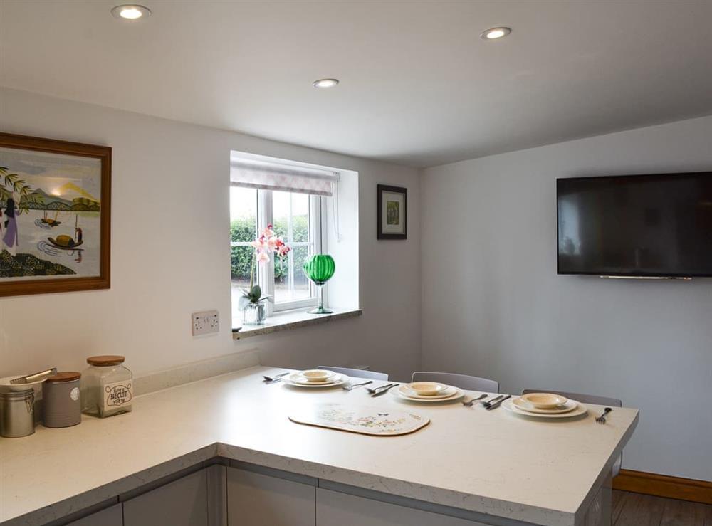Kitchen with breakfast bar (photo 2) at Moss Hall Barn in Rushton, near Tarporley, Cheshire
