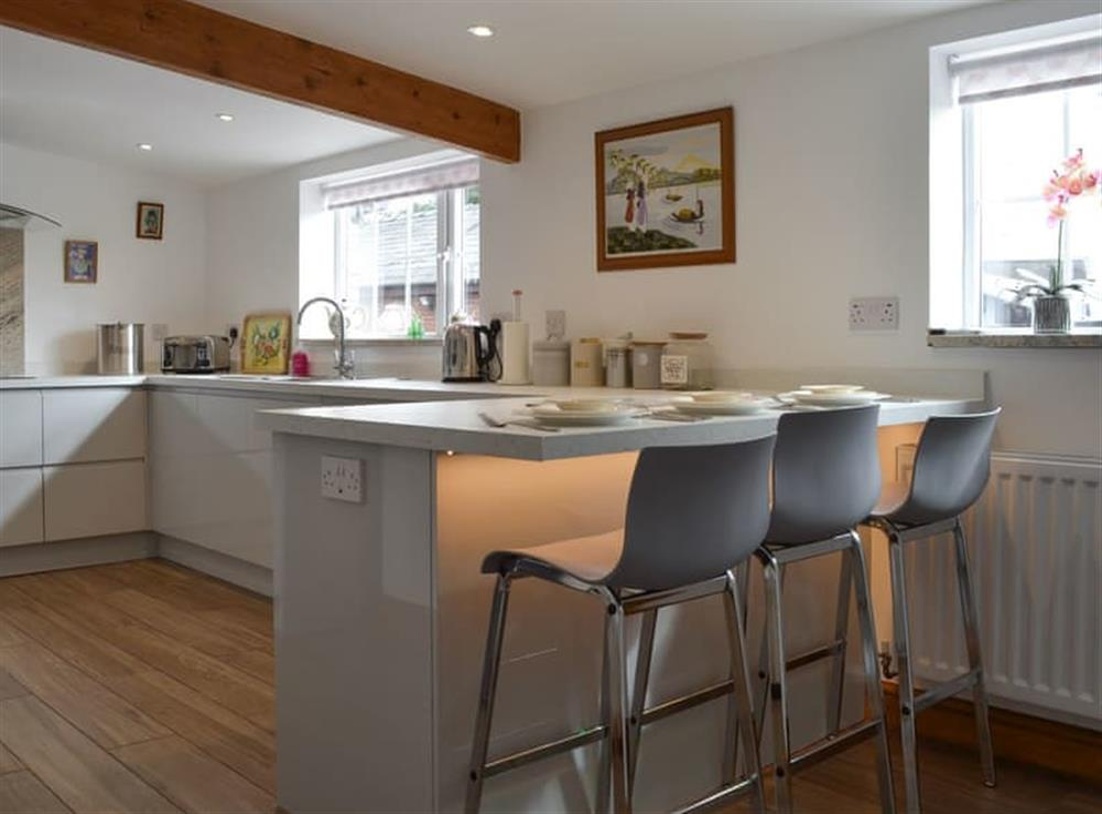 Kitchen with breakfast bar at Moss Hall Barn in Rushton, near Tarporley, Cheshire
