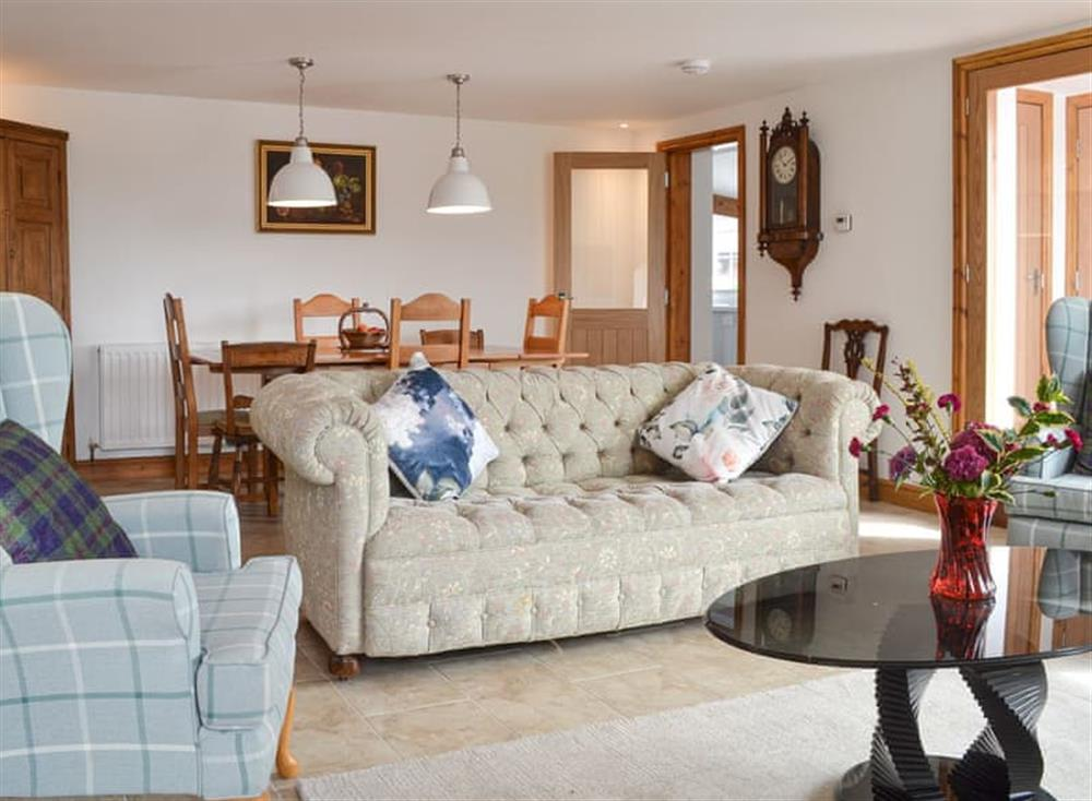 Living room with dining area at Moss Hall Barn in Rushton, near Tarporley, Cheshire