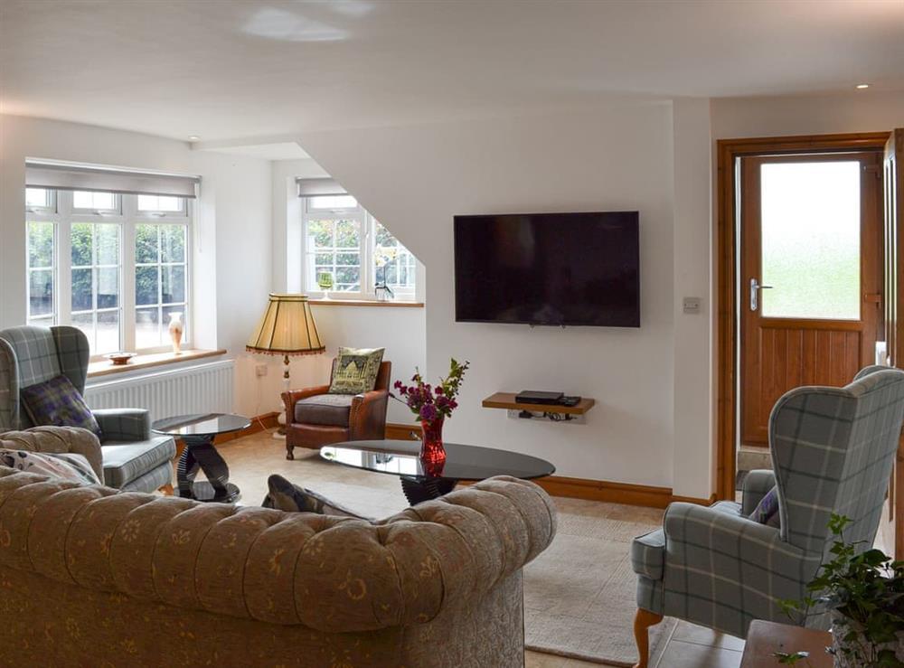 Living room at Moss Hall Barn in Rushton, near Tarporley, Cheshire