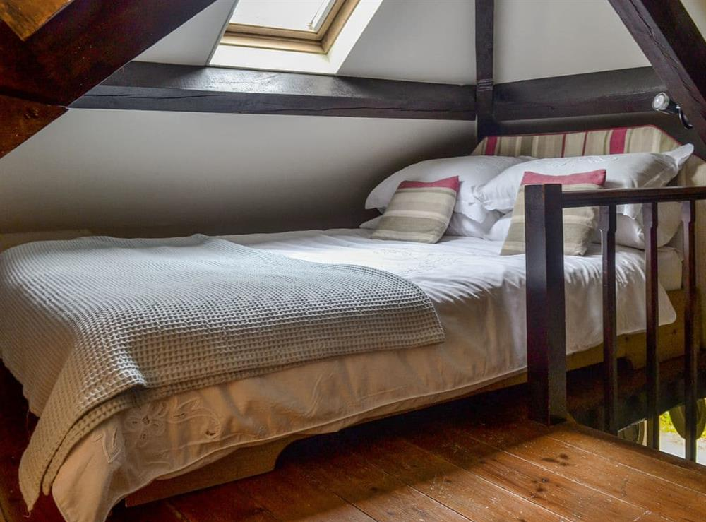 Galleried with double bed and low ceiling at The Pumphouse,