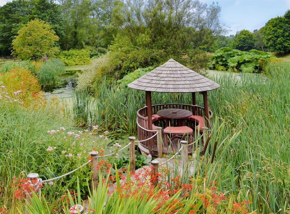 Large pond in the grounds where guests can sit and enjoy the surroundings. at The Pumphouse,