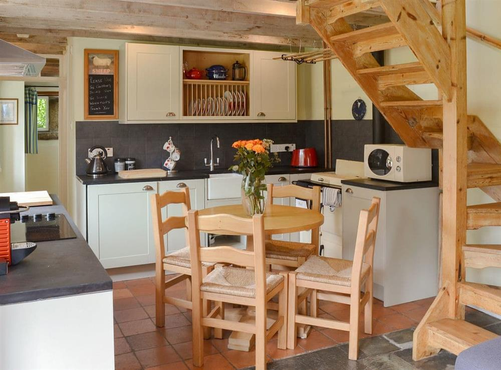 Charming open plan living space with well equipped kitchen area at The Woodshed,