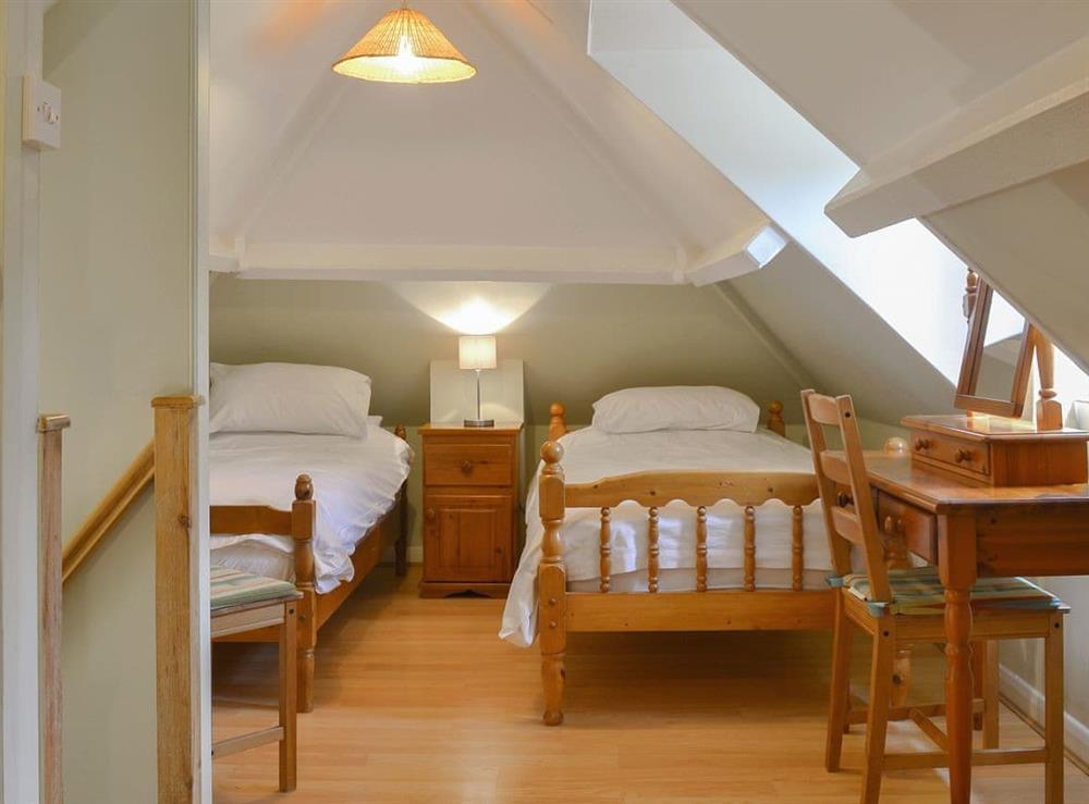 Comfortable twin bedroom at The Woodshed,