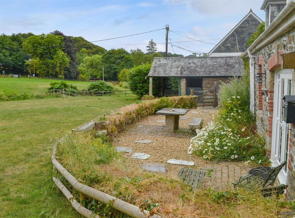 Sitting out area in the garden with countryside views at The Woodshed,