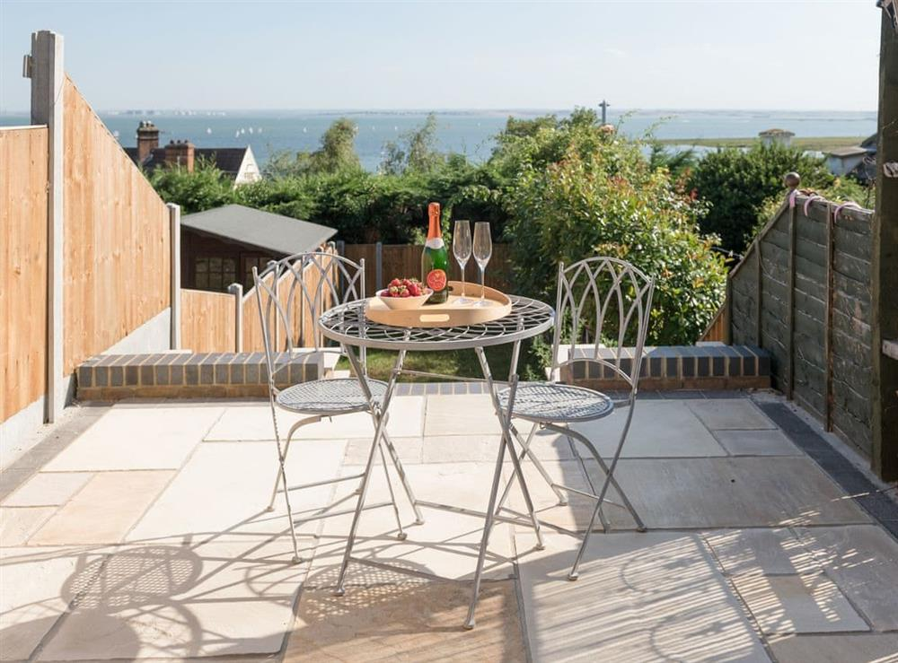 Paved rear patio with wonderful sea views at Mulberry Cottage in Leigh-on-Sea, Essex