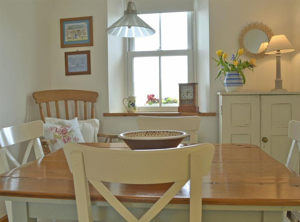 Dining area at Mur Llwyd in Rhoshirwaun, near Pwllheli, Gwynedd