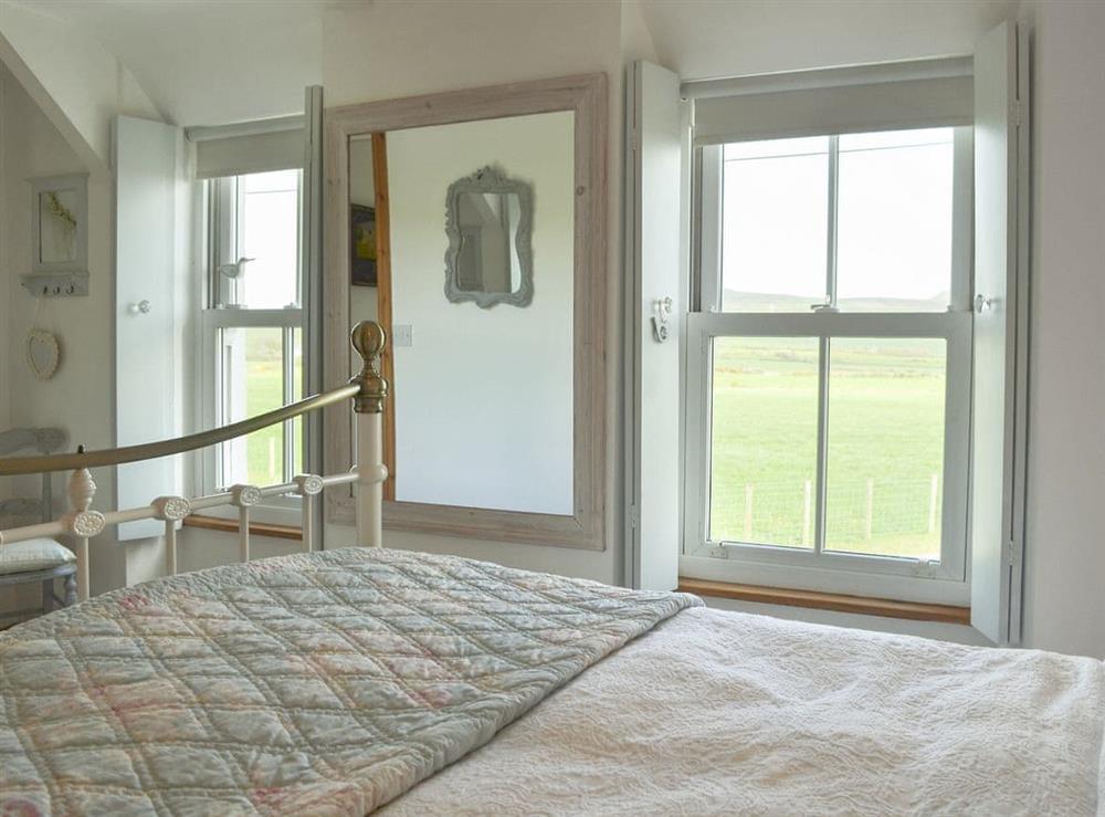 Elegantly furnished bedroom with double bed at Mur Llwyd in Rhoshirwaun, near Pwllheli, Gwynedd