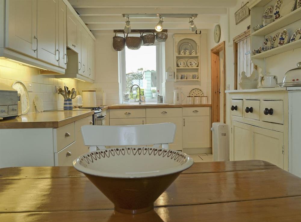 Open plan kitchen/dining space at Mur Llwyd in Rhoshirwaun, near Pwllheli, Gwynedd