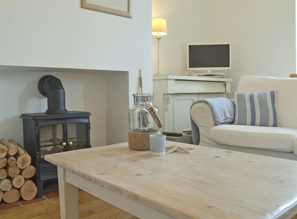 Relax and unwind in this comfortable living area at Mur Llwyd in Rhoshirwaun, near Pwllheli, Gwynedd
