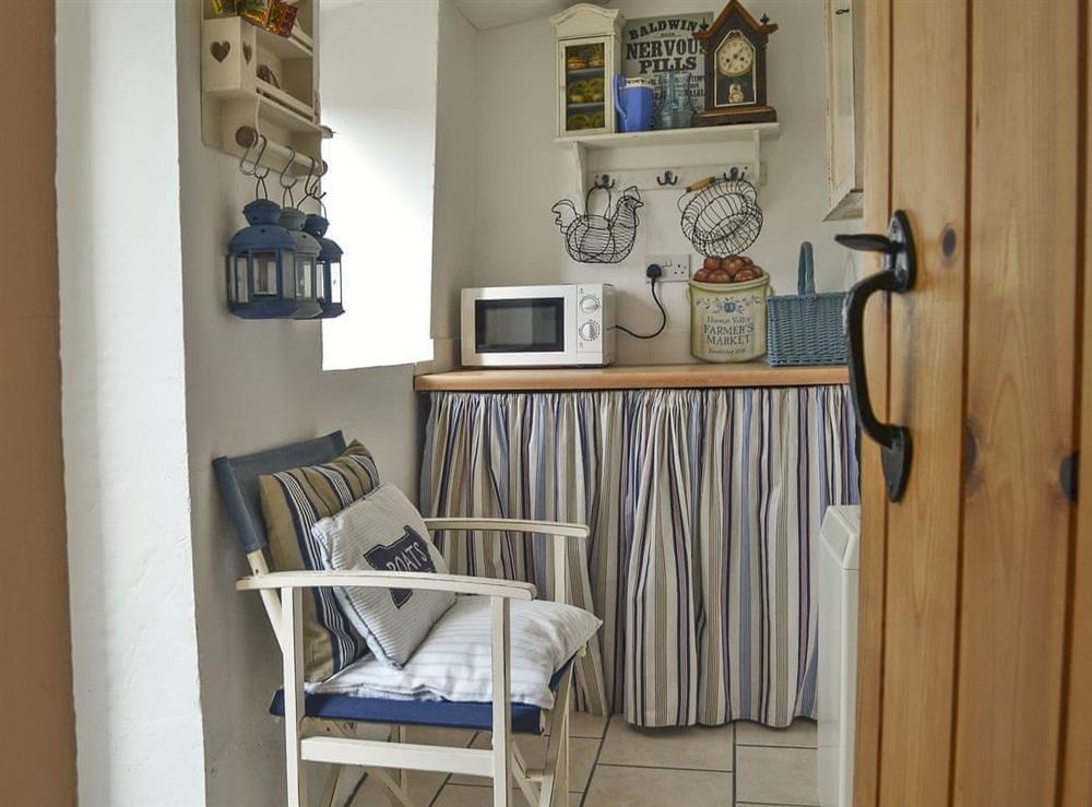 Utility room hosting freezer and washing machine at Mur Llwyd in Rhoshirwaun, near Pwllheli, Gwynedd