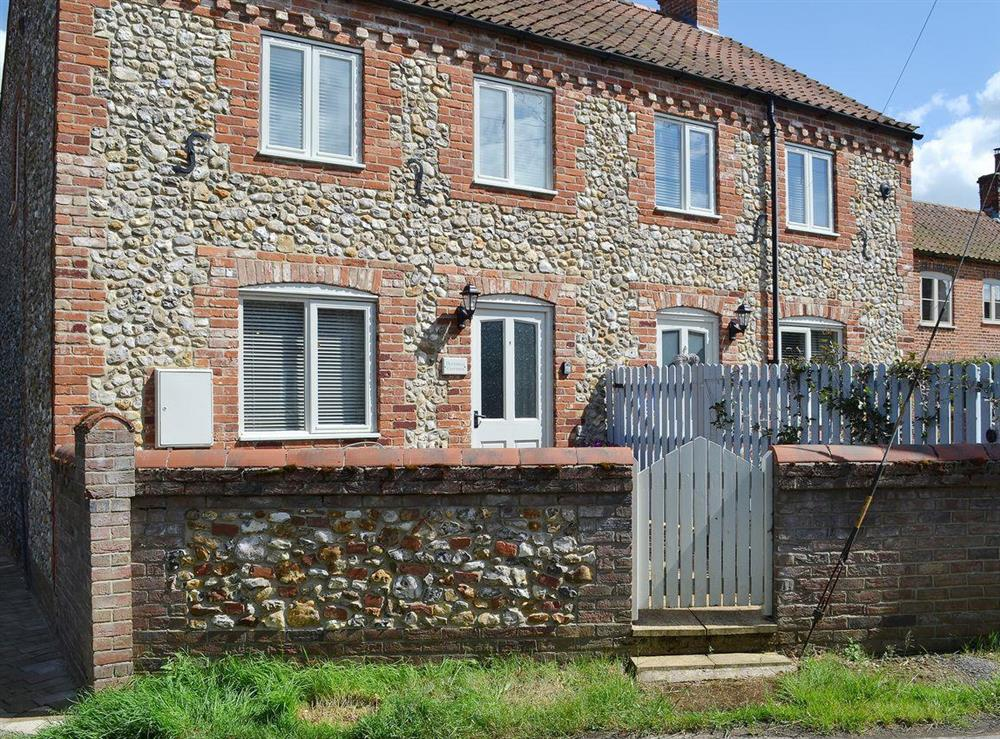 Attractive flint and brick semi-detached holiday cottage at Bluebell Cottage,