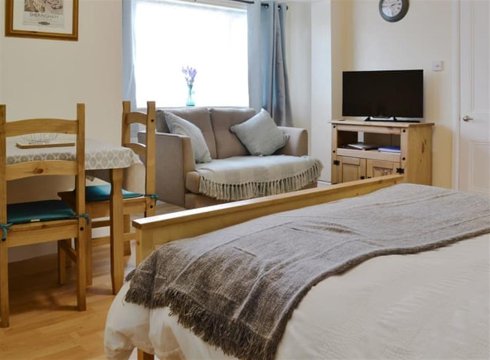 Cosy bedroom/ living/ dining area at New Inn Lodge in Scarning, near Dereham, Norfolk