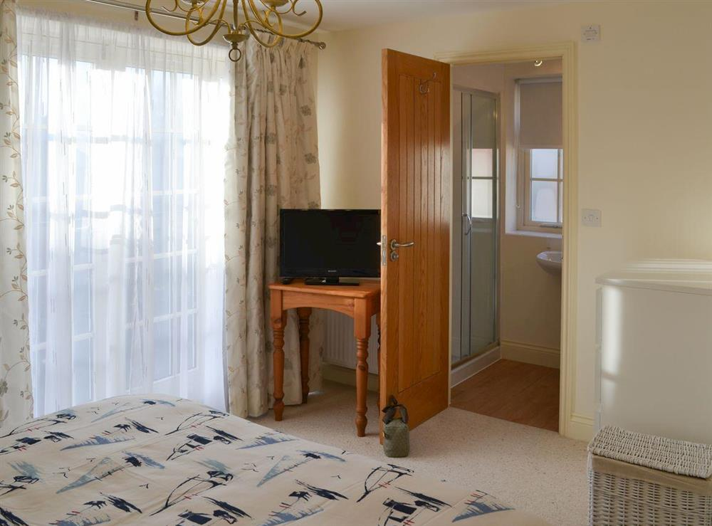 Double bedroom with en-suite at New Mill in Stalham Staithe, near Stalham, Norfolk