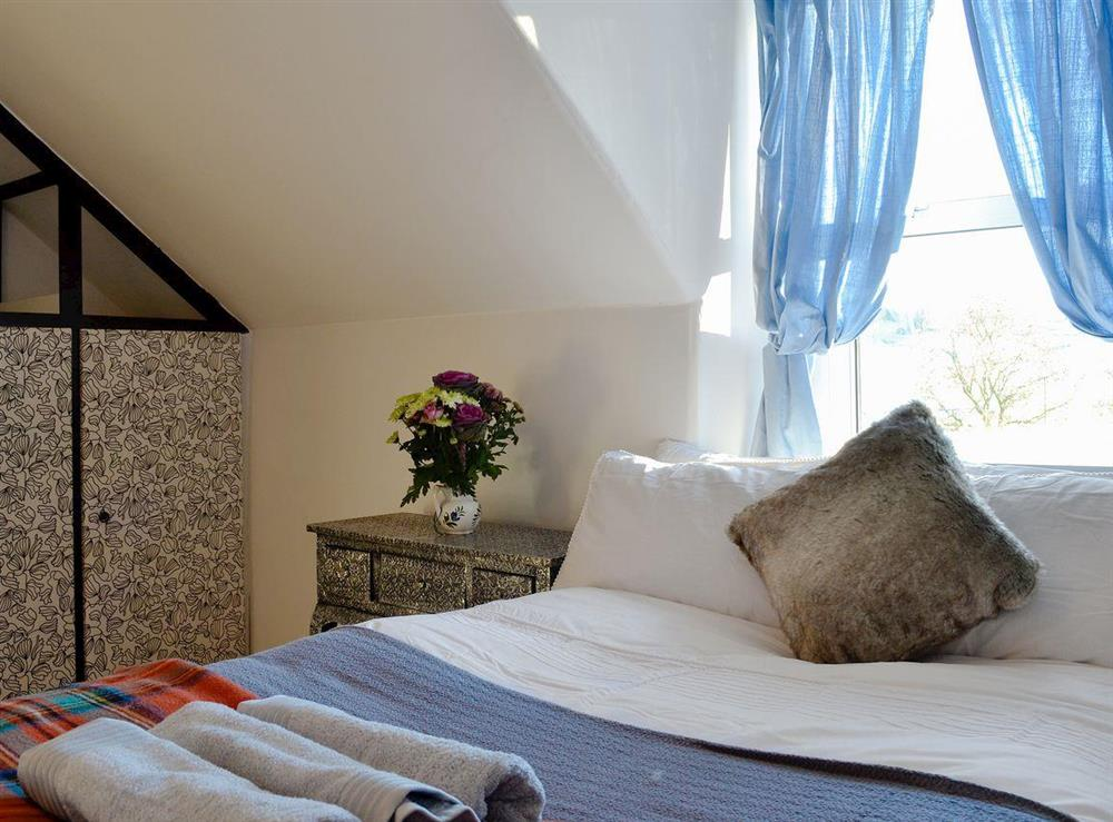 Cosy bedroom with single bed and ¾ double bed at North Balloch Farmhouse in Barr, near Girvan, Ayrshire